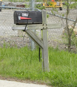 This mailbox is holding on for dear life.  Thank goodness for the bungee cord!