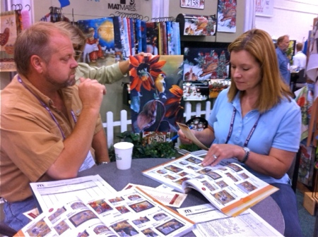 New Magnet Works customers, Scott and Annie Buschkoetter from Buschkoetter's Nursery placing an order with Deb.