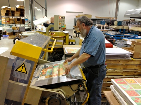 Jerry, who has worked with us since 1988, is die-cutting the DrinkBlots into the coaster shape.