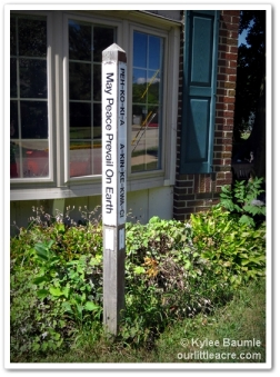 Peace pole in front of the meeting house at Manchester University, North Manchester, Indiana.